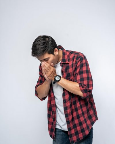 man-coughing-covering-her-mouth-with-her-hand (1)