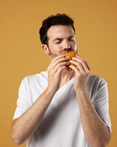 man-enjoying-eating-burger (1)