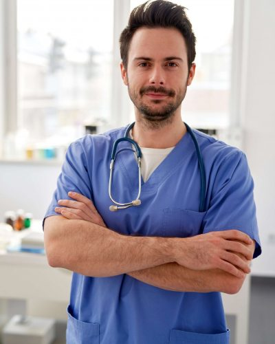 portrait-of-young-smiling-doctor-in-the-doctors-of-GB3RUNL (1)