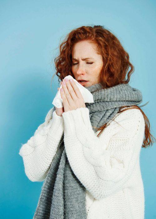 sick-girl-sneezing-wiping-her-nose (1)