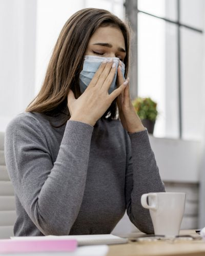 woman-wearing-face-mask-while-working-from-home